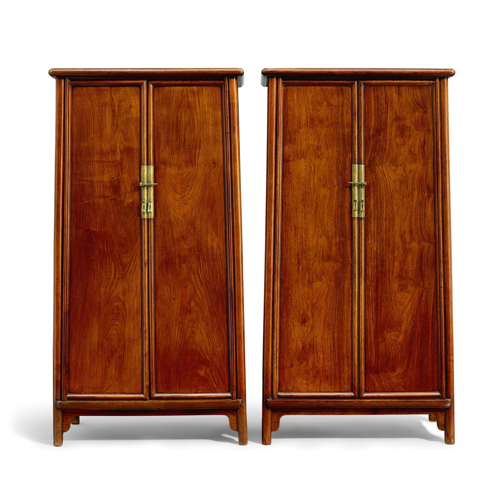 View full screen - View 1 of Lot 19. A pair of huanghuali round-cornered tapered cabinets, yuanjiaogui Late Ming – early Qing dynasty   明末至清初 黃花梨圓角櫃成對.