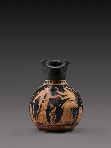 View 1. Thumbnail of Lot 32. A Paestan Red-figured Oinochoe, circa 350-340 B.C..