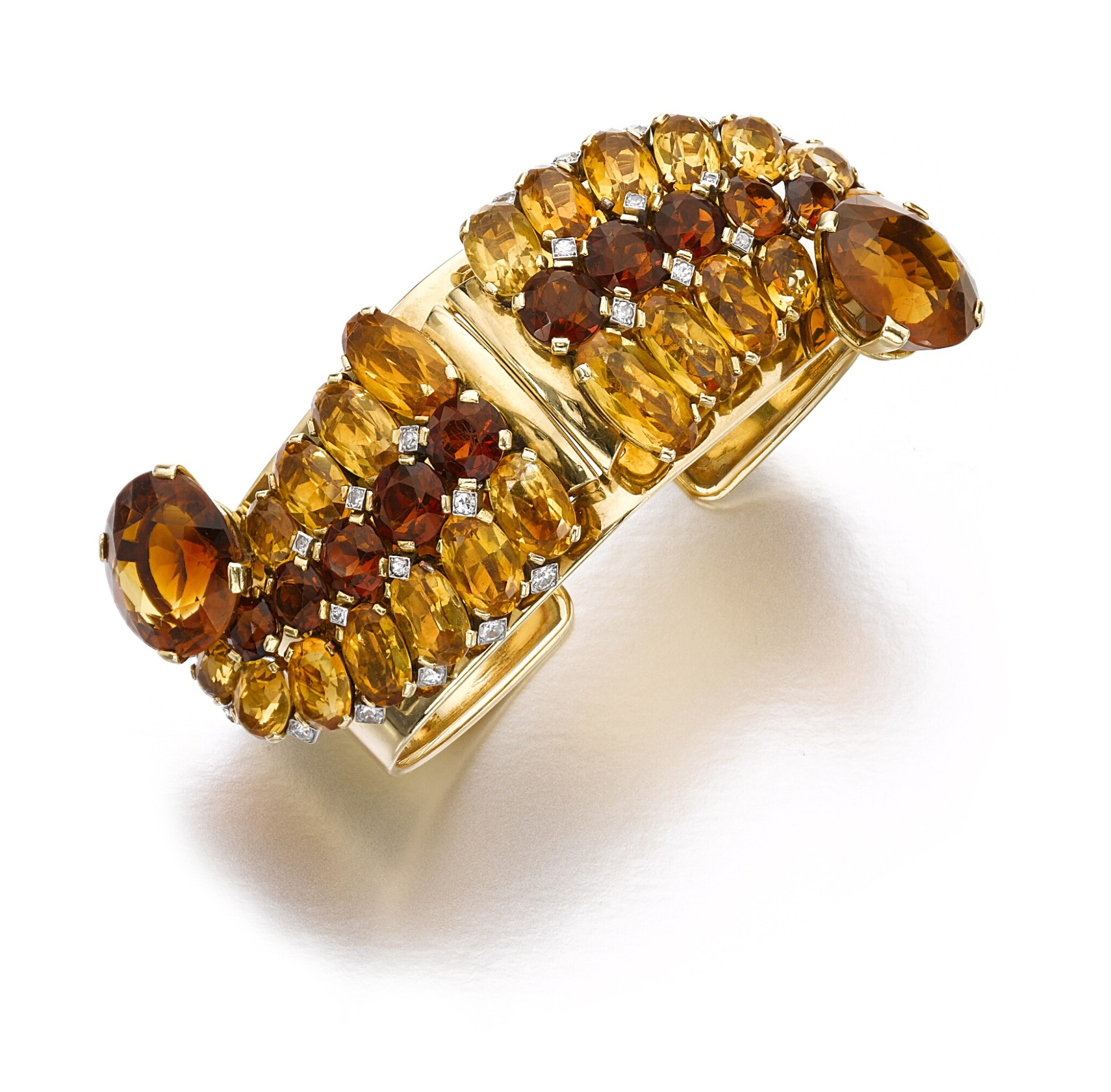 View full screen - View 1 of Lot 110. Cartier | Pair of citrine and diamond clips/bangle combination, circa 1940 | 卡地亞 | 黃水晶配鑽石別針一對/手鐲組合,約1940年.