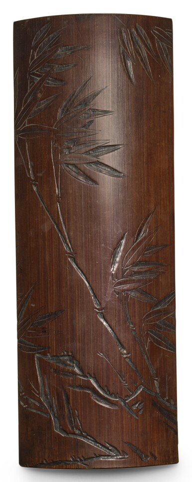 View 1. Thumbnail of Lot 285. A CARVED BAMBOO WRISTREST QING DYNASTY, 19TH CENTURY | 清十九世紀 竹雕竹石圖臂擱.