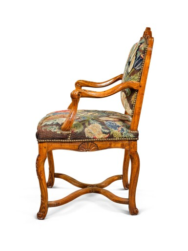 View 3. Thumbnail of Lot 52. A Régence provincial carved beechwood fauteuil, circa 1730.
