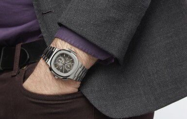 View 4. Thumbnail of Lot 14. PATEK PHILIPPE   NAUTILUS REF 5990/1A, A STAINLESS STEEL AUTOMATIC DUAL TIME ZONE CHRONOGRAPH BRACELET WATCH WITH LOCAL AND HOME INDICATORS CIRCA 2018.
