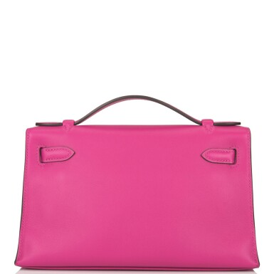 View 4. Thumbnail of Lot 16. Hermès Rose Pourpre Mini Kelly Pochette of Swift Leather with Palladium Hardware.