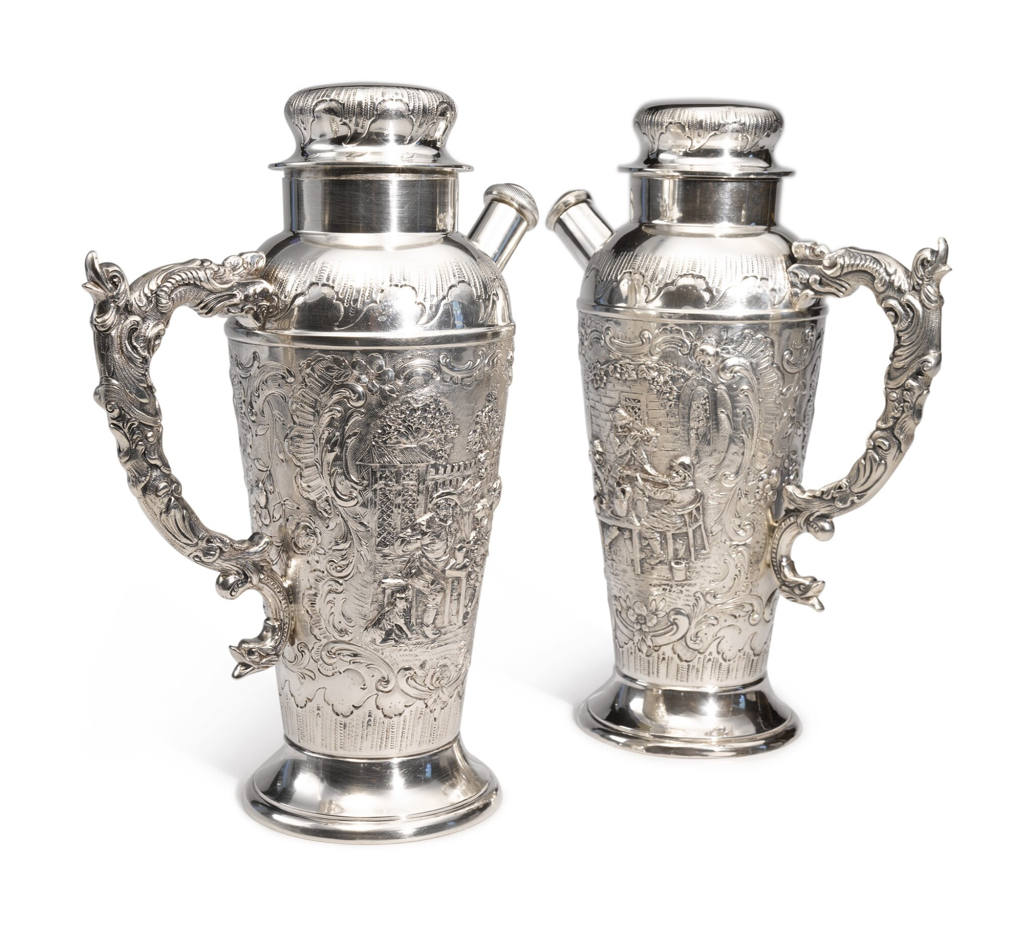 View full screen - View 1 of Lot 322. A PAIR OF GERMAN SILVER COCKTAIL SHAKERS, MAKER'S MARK WH/H IN CIRCLE, CIRCA 1900.
