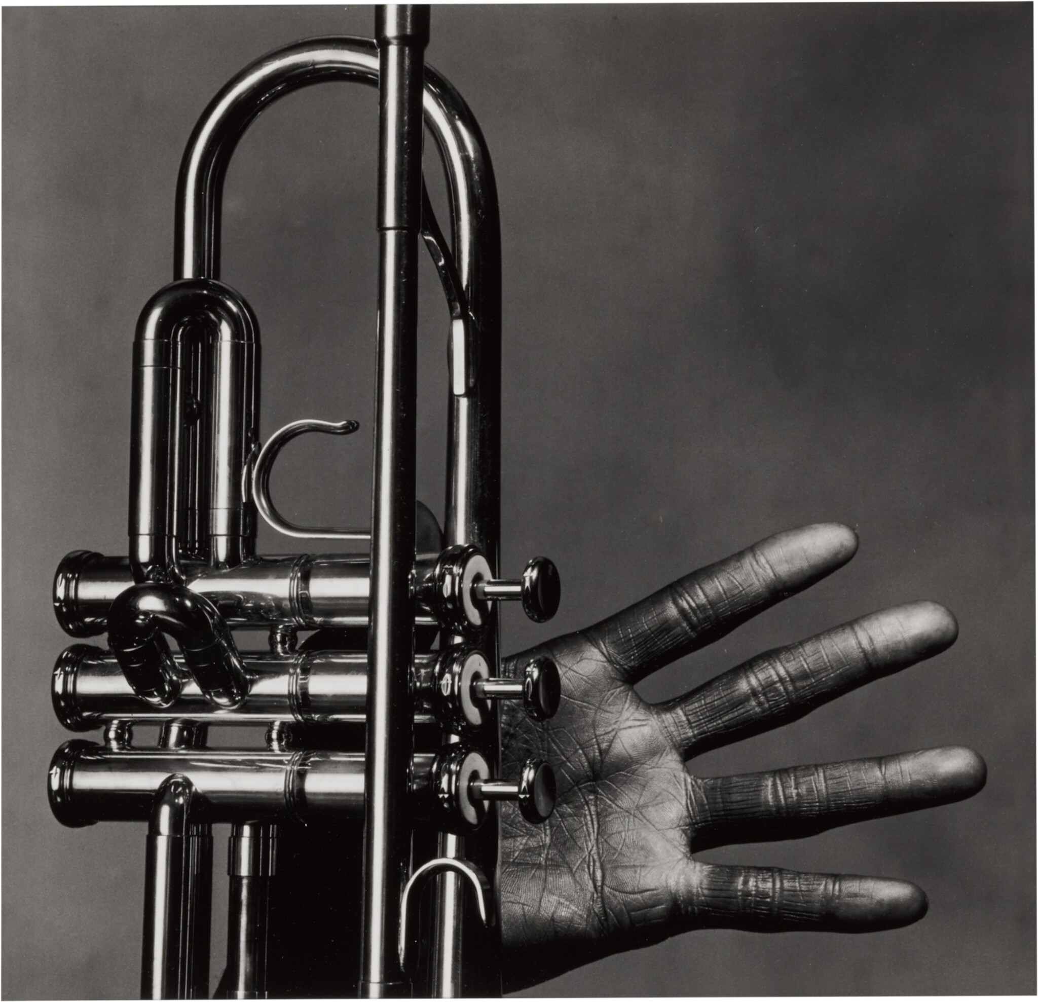 View full screen - View 1 of Lot 8. 'Miles Davis, Hand and Trumpet, New York' .