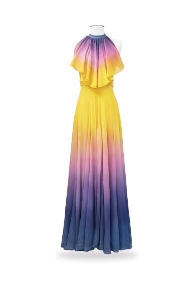 View 3. Thumbnail of Lot 10. Balestra, 1972, Sunbathing dress with pleated collar and matching cape | Robe longue bain de soleil à collerette plissée en mousseline avec cape assortie.