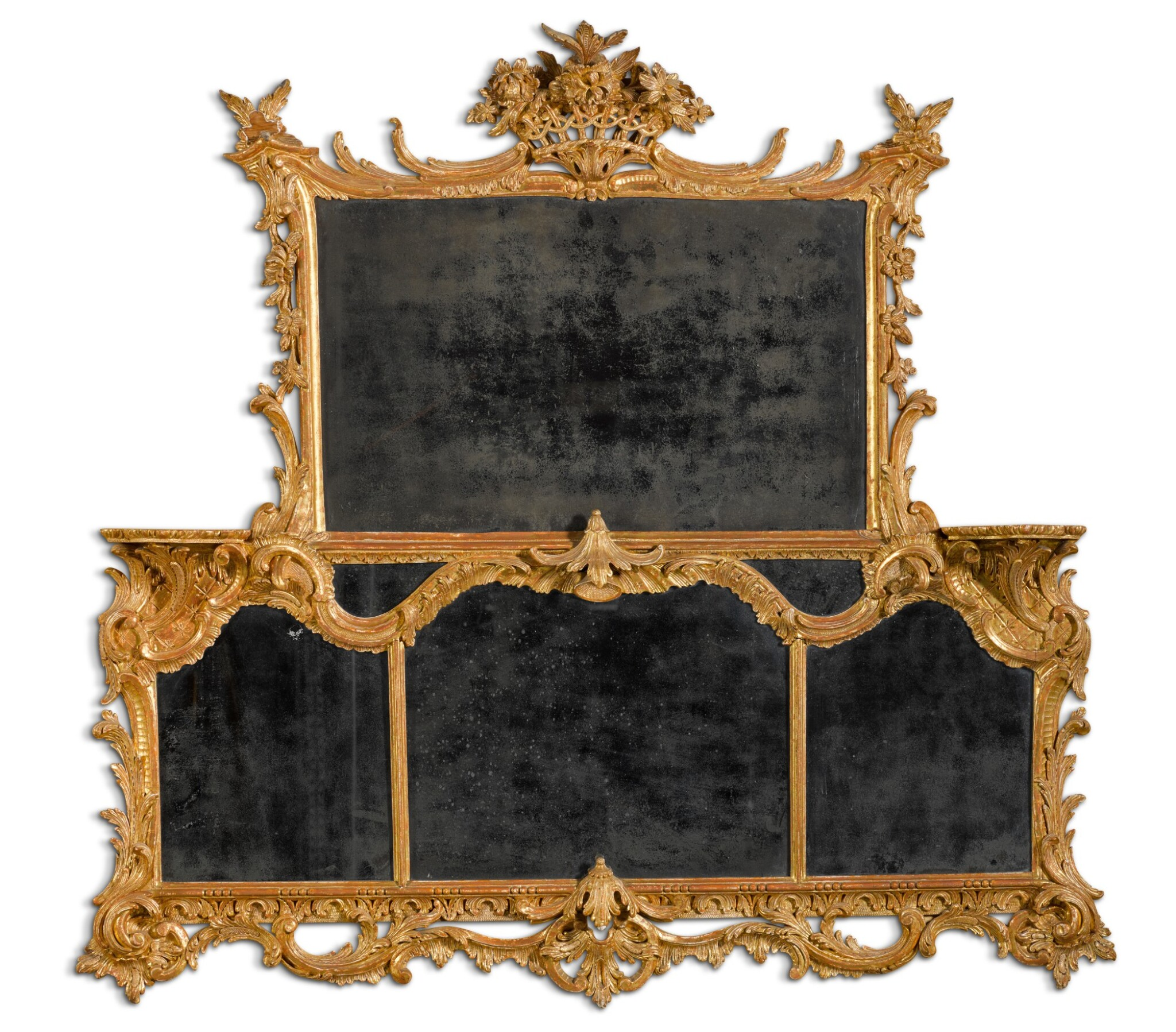 View full screen - View 1 of Lot 68. A George II carved giltwood overmantel mirror, circa 1755-60.