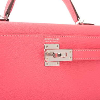 View 7. Thumbnail of Lot 29. HERMÈS   ROSE LIPSTICK SELLIER KELLY 20CM OF CHEVRE LEATHER WITH PALLADIUM HARDWARE.