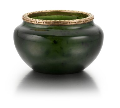 View 1. Thumbnail of Lot 49. A Fabergé two colour gold-mounted nephrite bowl, workmaster Michael Perchin, St Petersburg, 1899-1903.