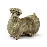 A celadon-glazed 'Yue' figure of a ram, Western Jin dynasty | 西晉 越窰青釉臥羊