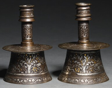 View 1. Thumbnail of Lot 103. TWO MINIATURE MAMLUK SILVER AND GOLD-INLAID BRASS CANDLESTICKS, EGYPT OR SYRIA, EARLY 15TH CENTURY.