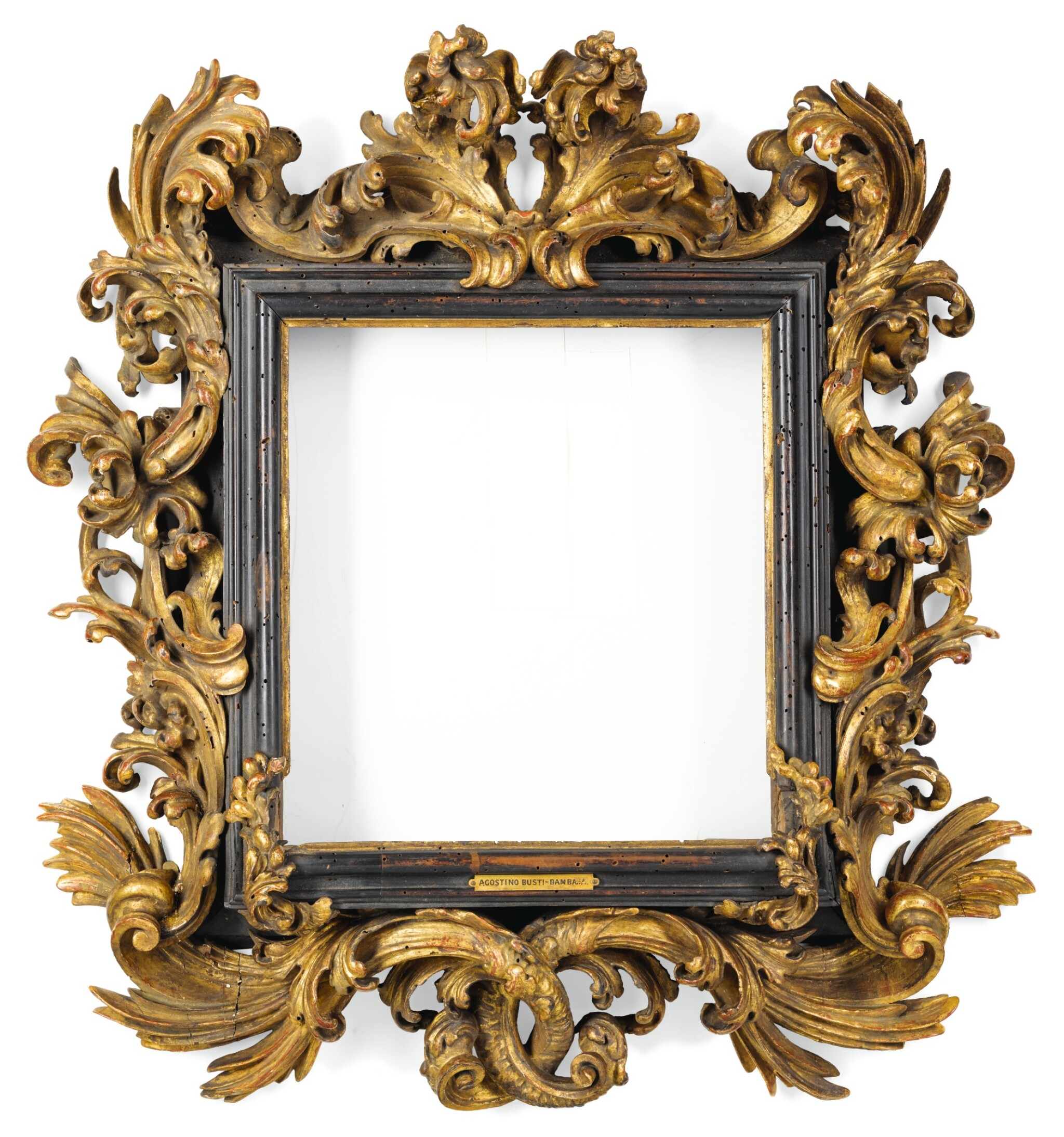 View full screen - View 1 of Lot 123. A NORTH ITALIAN BAROQUE CARVED GILTWOOD PICTURE FRAME, IN THE MANNER OF THE FANTONI WORKSHOP EARLY 18TH CENTURY.