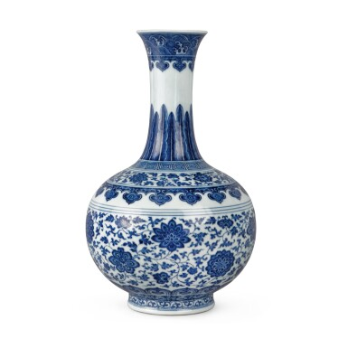 View 1. Thumbnail of Lot 75. A blue and white Ming-style bottle vase, Seal mark and period of Qianlong | 清乾隆 青花纏枝花卉紋賞瓶 《大清乾隆年製》款.