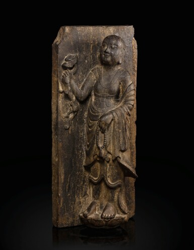View 1. Thumbnail of Lot 51. A rare limestone carving of a Buddhist acolyte, possibly Jianglong Luohan Northern Song dynasty, 10th-11th century   北宋十至十一世紀 石灰石浮雕或為降龍羅漢像.