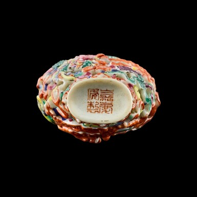 View 3. Thumbnail of Lot 1003. A famille-rose porcelain 'dragon and phoenix' snuff bottle Seal mark and period of Jiaqing   清嘉慶 粉彩雕瓷龍鳳呈祥紋鼻煙壺 《嘉慶年製》款.