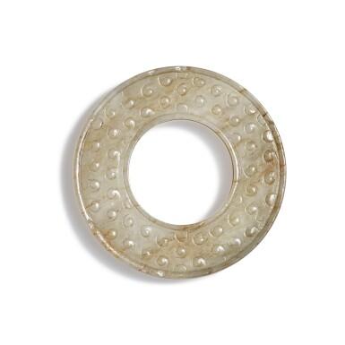 View 1. Thumbnail of Lot 100. A small beige jade disc, Warring States period - Han dynasty   戰國至漢 玉穀紋環.