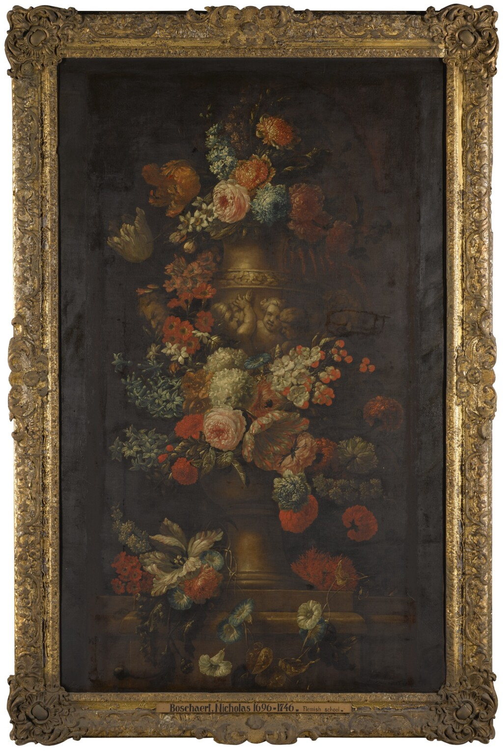 JAN BAPTIST BOSSCHAERT | Still life of flowers including tulips, roses, and turban rannunuculous, in a stone urn decorated with putti, all on a stone ledge