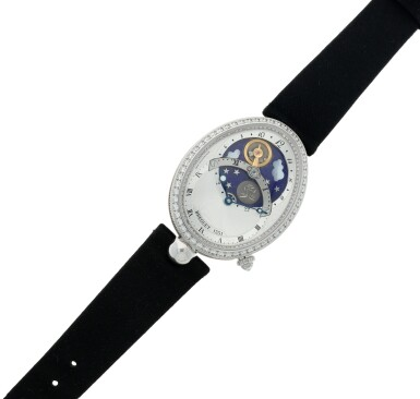 View 7. Thumbnail of Lot 107. Reference 8998 Reine De Naples A white gold and diamond-set automatic oval wristwatch with moon phases and 24-hour indication, Circa 2015.