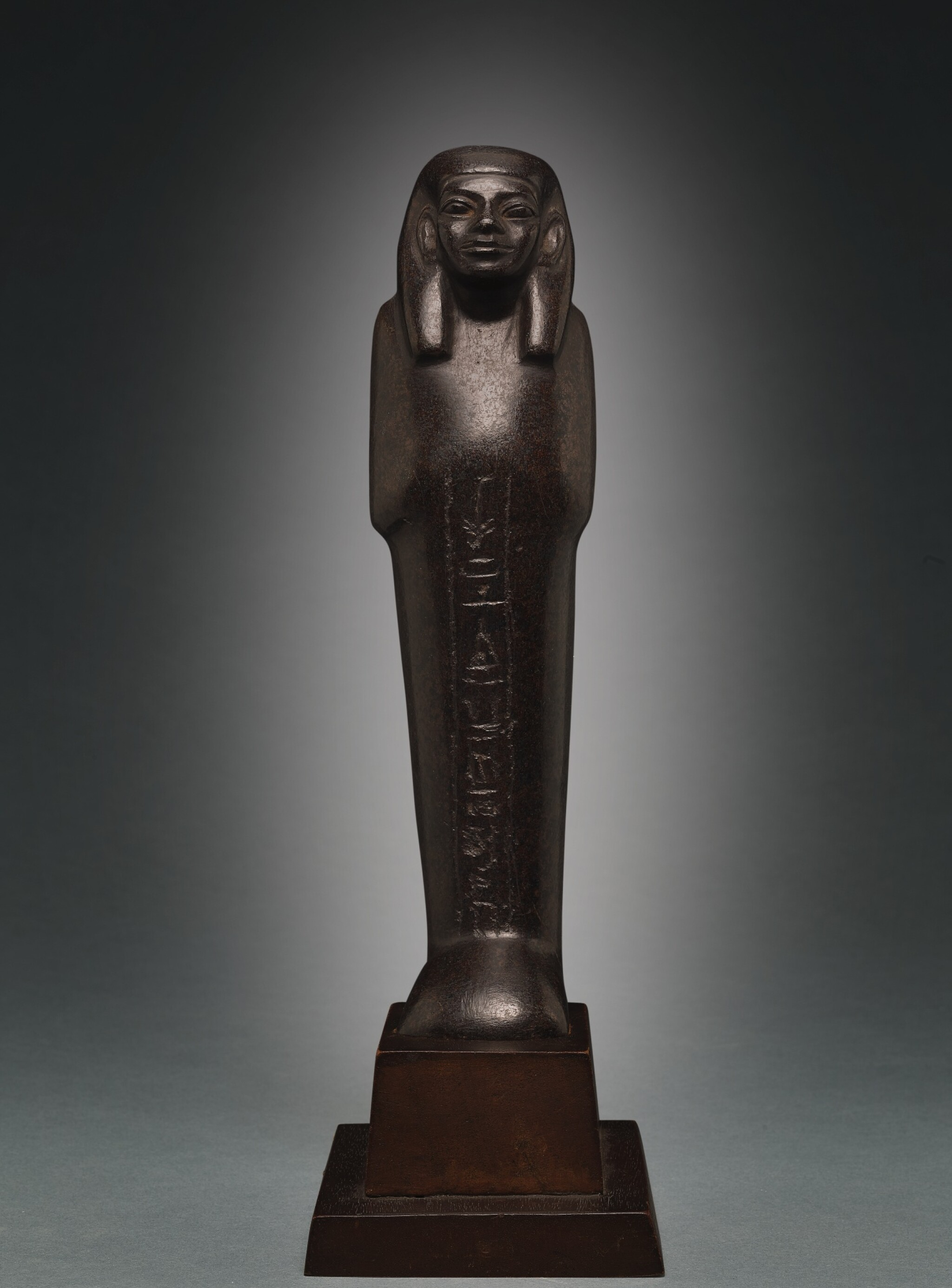 View full screen - View 1 of Lot 66. AN EGYPTIAN BROWN SERPENTINE USHABTI OF NEDJEM-IB, LATE 12TH/13TH DYNASTY, CIRCA 1800-1640 B.C..