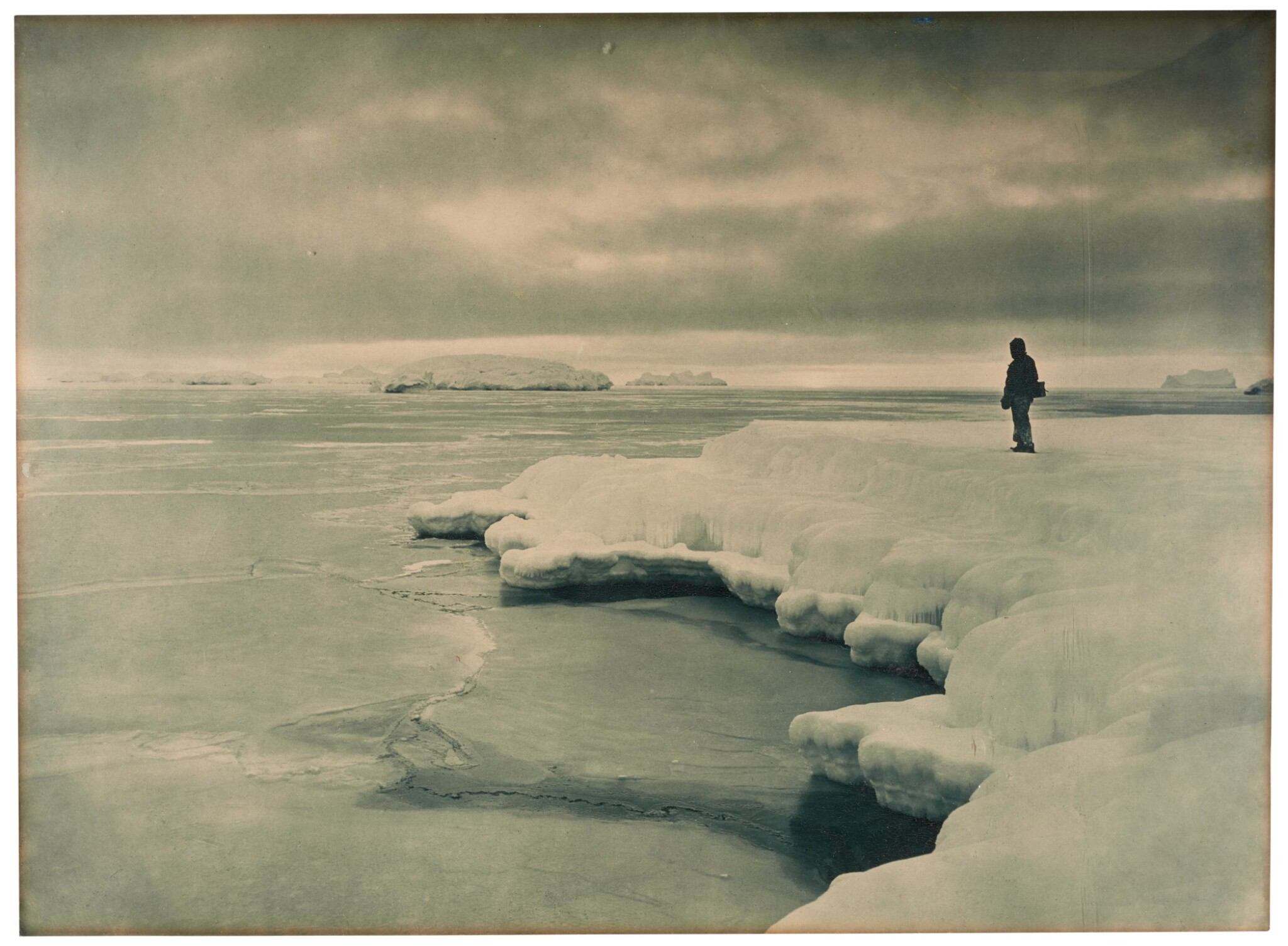 View full screen - View 1 of Lot 188. Australasian Antarctic Expedition, 1911-1914—Frank Hurley | The Pallid Glow of a Midwinter Noon at Cape Denison.