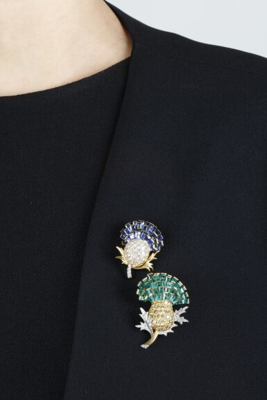 View 5. Thumbnail of Lot 303. VERDURA | PAIR OF SAPPHIRE, EMERALD AND DIAMOND BROOCHES, 'THISTLE', 1960.