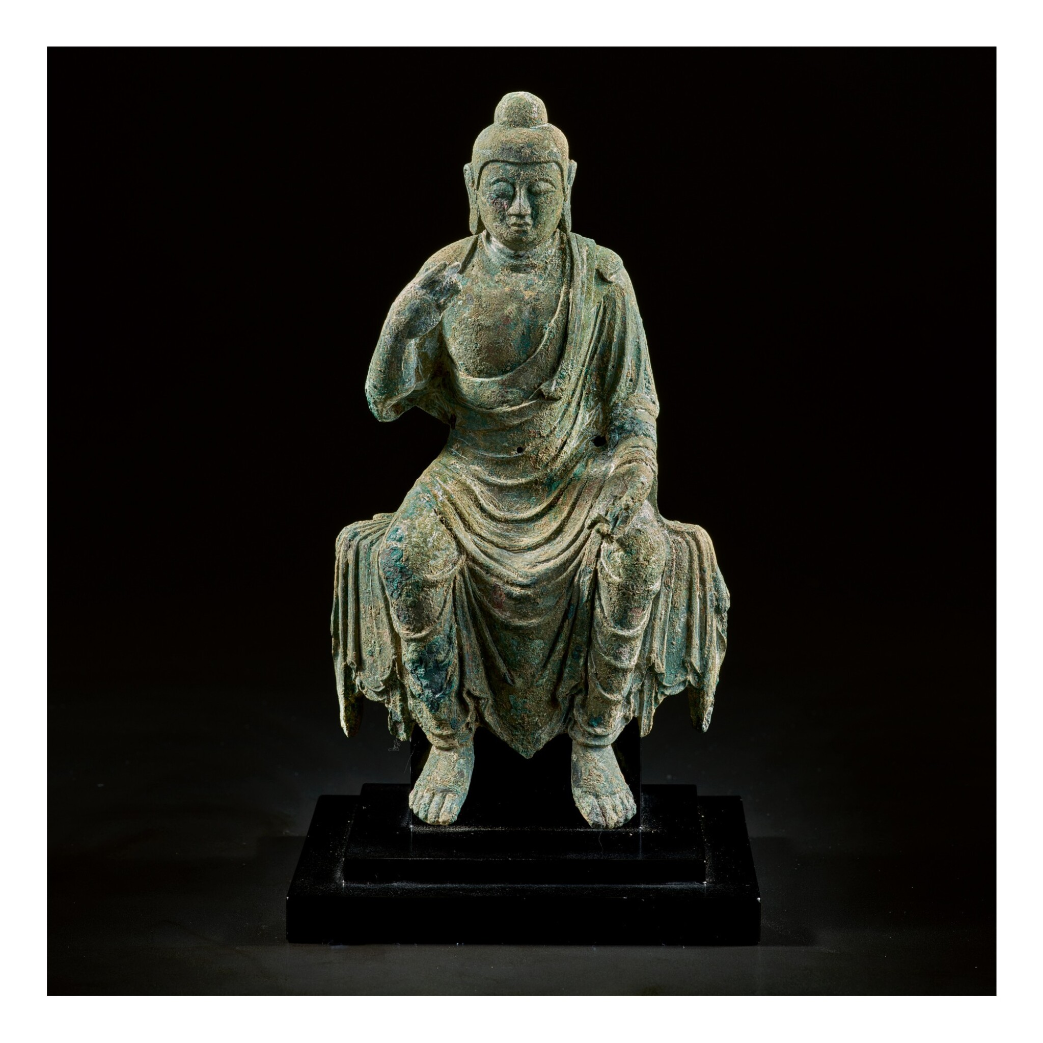 View 1 of Lot 585. A BRONZE FIGURE OF BUDDHA,  TANG DYNASTY.
