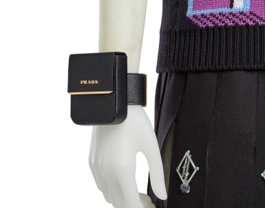 View 6. Thumbnail of Lot 34. PRADA   OPEN PLEATS EMBROIDERED WOOL SKIRT, WOOL VEST, PRINTED SHIRT AND TIE,   METAL HEADBAND AND VANITY BRACELET, WORN BY MATY FALL.   UNIQUE READY-TO-WEAR NOT IN THE STORES.