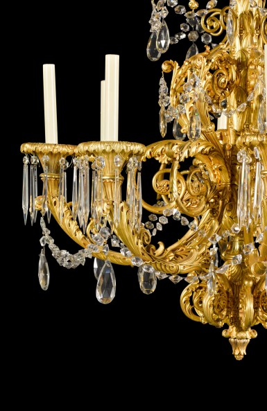View 3. Thumbnail of Lot 56. A gilt-bronze eight-light chandelier, possibly North European, second quarter 19th century.