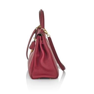 View 3. Thumbnail of Lot 2. HERMÈS | ROUGE COLOUR KELLY RETOURNÉ 28 IN TOGO LEATHER  WITH GOLD HARDWARE, 2017.