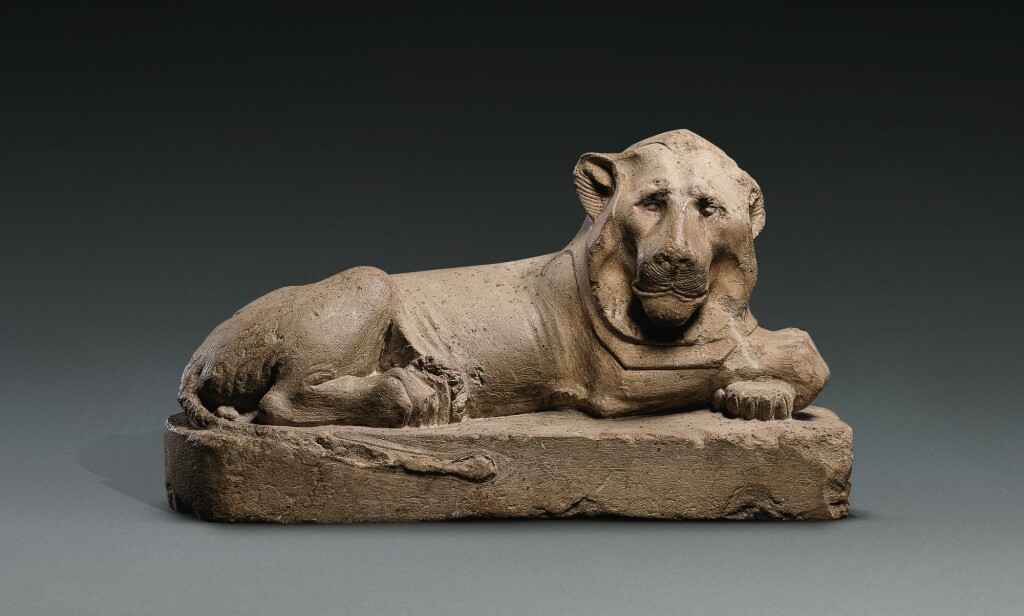 AN EGYPTIAN LIMESTONE FIGURE OF A LION, 30TH DYNASTY, 380-342 B.C.