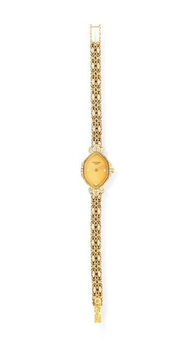 View 1. Thumbnail of Lot 121. Patek Philippe | Montre bracelet de dame or et diamants | Lady's gold and diamond bracelet watch.