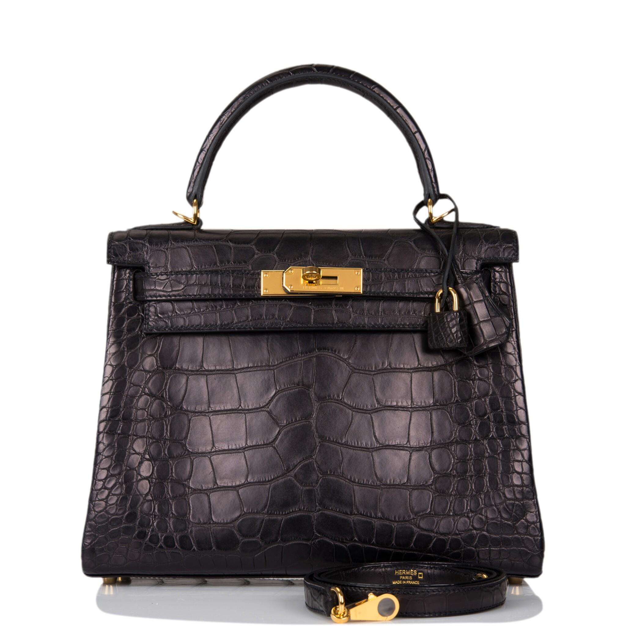 View full screen - View 1 of Lot 44. Hermès Black Retourne Kelly 28cm of Matte Alligator with Gold Hardware.