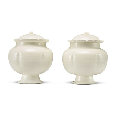 View 2. Thumbnail of Lot 184. A pair of white-glazed footed jars and covers, Northern Song / Jin dynasty | 北宋 / 金 白釉瓜棱式高足蓋罐一對.