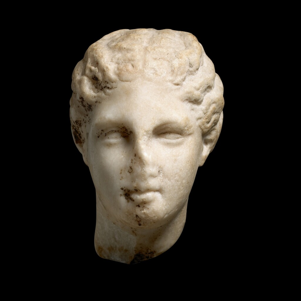 A GREEK HEAD OF A YOUNG WOMAN, CIRCA MID 4TH CENTURY B.C.