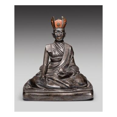 A SILVER FIGURE OF THE FIFTH SHARMAPA, KONCHOK YANGLAK,  TIBET, 17TH CENTURY