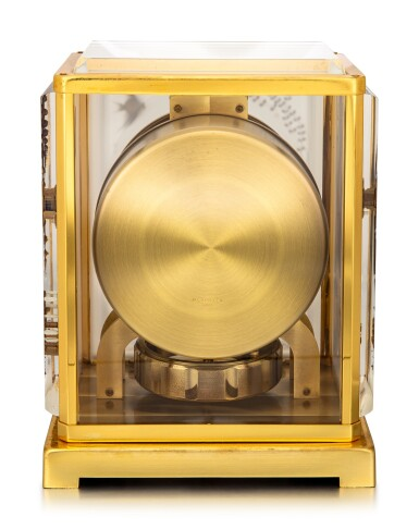 JAEGER-LECOULTRE | ATMOS, A GILT BRASS ATMOS CLOCK WITH ANGELFISH MOTIF PANELS ENGRAVED PERSPEX, CIRCA 1970