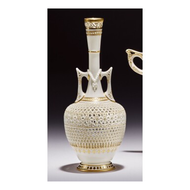 A ROYAL WORCESTER RETICULATED PORCELAIN TWO-HANDLED VASE BY GEORGE OWEN DATED 1912