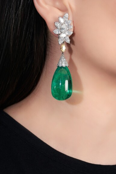 View 5. Thumbnail of Lot 107. Harry Winston | Pair of impressive emerald and diamond ear clips.