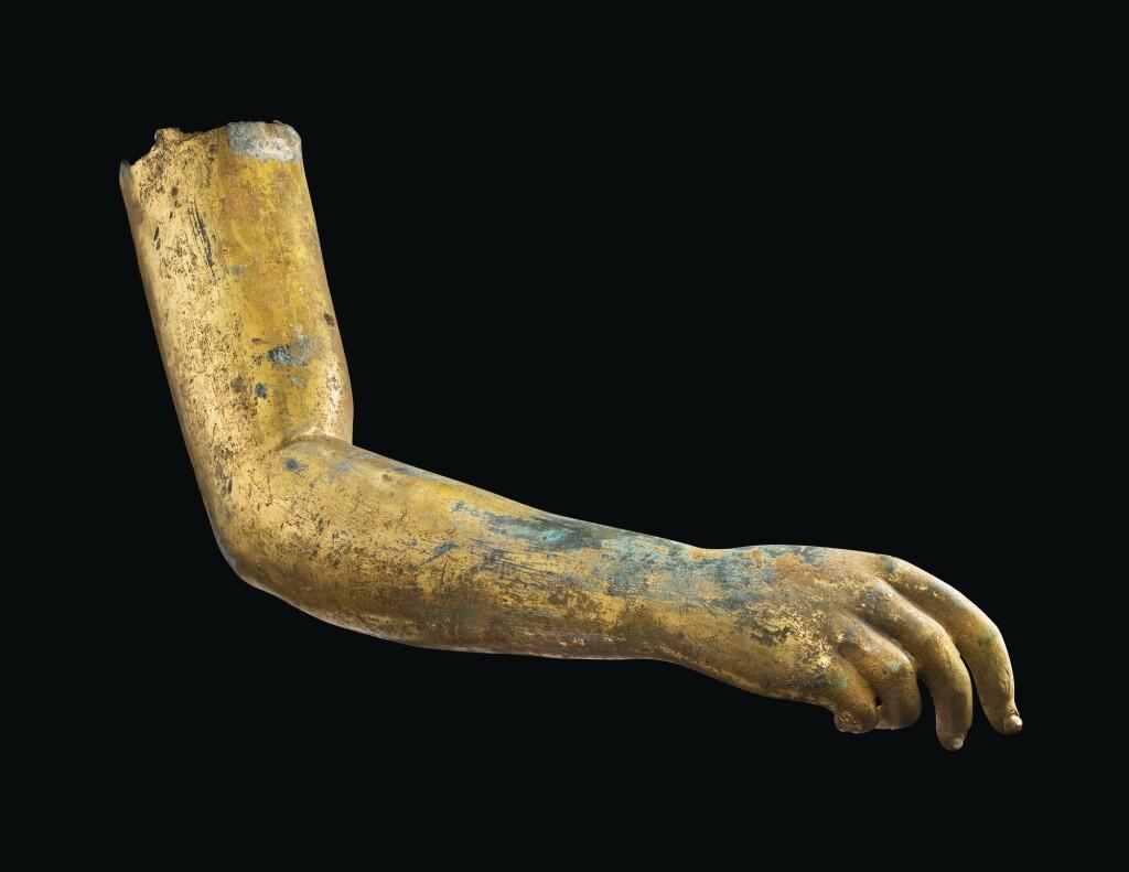 A ROMAN GILT BRONZE ARM, CIRCA 2ND CENTURY A.D.