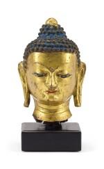 A GILT-BRONZE HEAD OF SHAKYAMUNI BUDDHA, TIBET, 15TH CENTURY    十五世紀 藏傳鎏金銅釋迦牟尼佛首