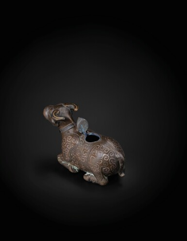 View 3. Thumbnail of Lot 48. A finely cast gold and silver inlaid archaistic 'recumbent buffalo' waterpot Yuan Dynasty -Ming Dynasty, 13th-15th century   元至明 十三至十五世紀 銅錯金銀臥牛水注.