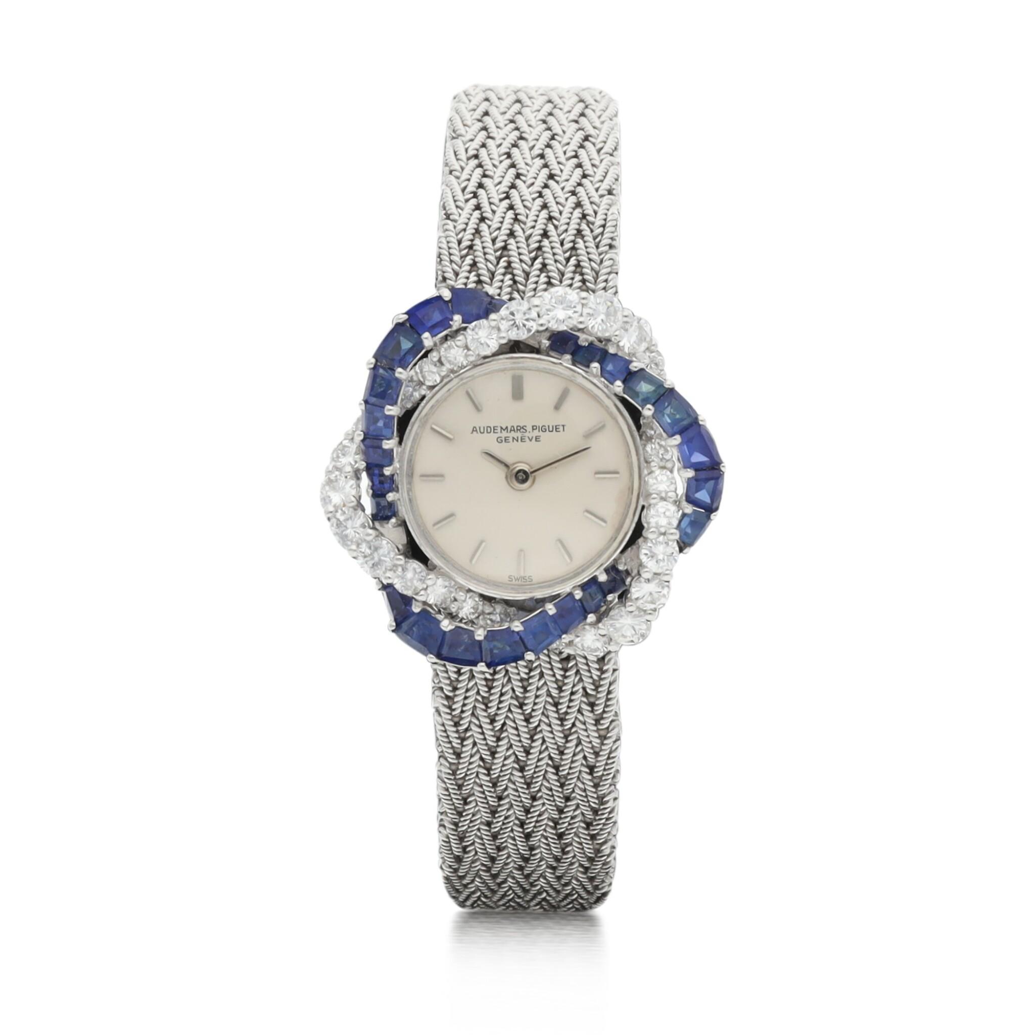 View 1 of Lot 8061. Audemars Piguet | Reference 9566, A white gold, diamond and sapphire-set bracelet watch, Circa 1960 | 愛彼 | 型號9566   白金鑲鑽石及藍寶石鏈帶腕錶,約1960年製.