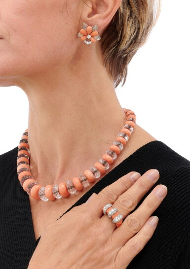 View 4. Thumbnail of Lot 70. CORAL AND DIAMOND RING, SIGNED CARTIER, CORAL AND ROCK CRYSTAL NECKLACE AND PAIR OF EARRINGS  (ANELLO IN CORALLO E DIAMANTI, FIRMATO CARTIER, COLLANA E PAIO DI ORECCHINI IN CORALLO, CRISTALLO DI ROCCA E DIAMANTI).
