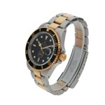ROLEX | 'PANAMA CANAL' SUBMARINER, REF 16613 LIMITED EDITION STAINLESS STEEL AND YELLOW GOLD WRISTWATCH WITH DATE AND BRACELET MADE TO COMMEMORATE THE TRANSFER OF THE PANAMA CANAL FROM THE UNITED STATES TO THE REPUBLIC OF PANAMA CIRCA 1999