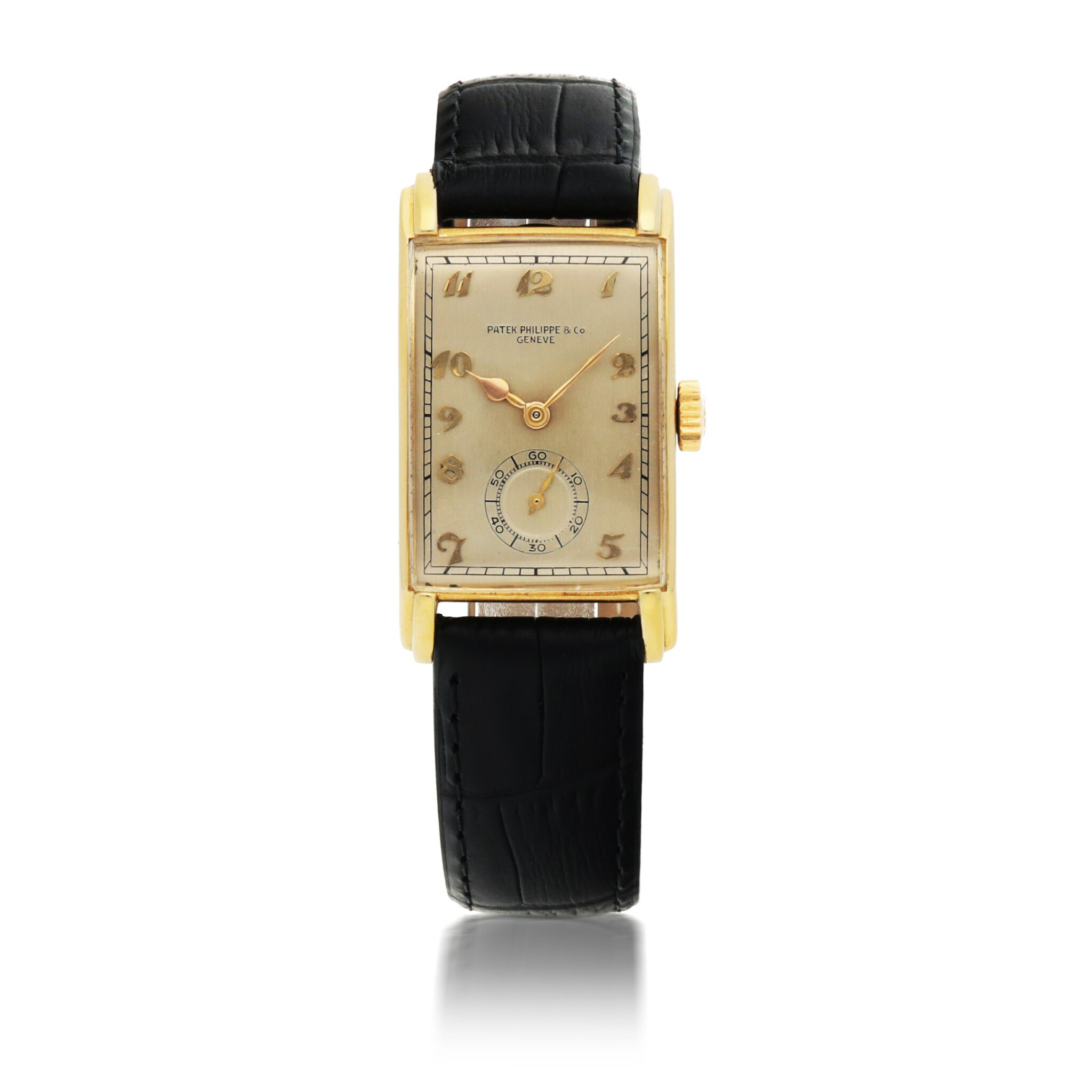 View full screen - View 1 of Lot 402. PATEK PHILIPPE | REF 1559 YELLOW GOLD WRISTWATCH MADE IN 1944.