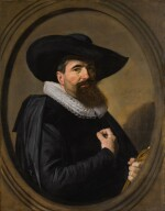FRANS HALS  |  PORTRAIT OF A MAN, HALF-LENGTH IN BLACK, WITH A BROAD-BRIMMED BLACK HAT AND A WHITE RUFF, HOLDING HIS GLOVES, WITHIN A PAINTED OVAL