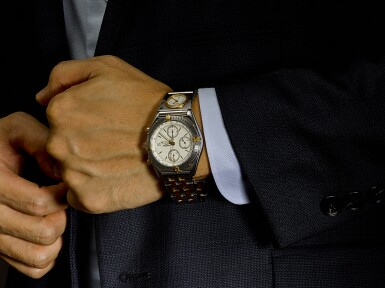 View 4. Thumbnail of Lot 8217. BREITLING | A STAINLESS STEEL AND YELLOW GOLD DUAL TIME ZONE CHRONOGRAPH WRISTWATCH WITH DATE AND BRACELET, CIRCA 2005.