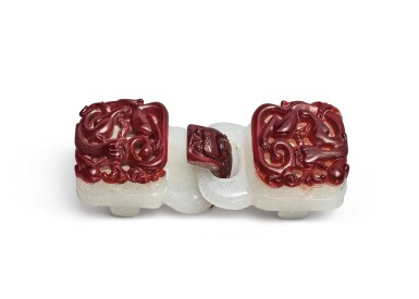 View 1. Thumbnail of Lot 1022.  A RED OVERLAY WHITE GLASS 'CHILONG' BELT BUCKLE,  QING DYNASTY, 18TH CENTURY.