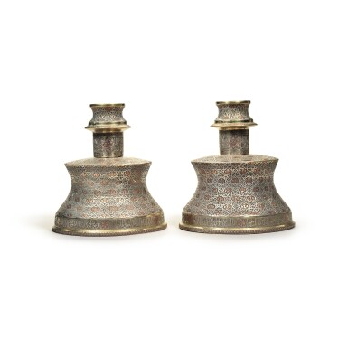 View 3. Thumbnail of Lot 137. A pair of Cairoware silver and copper-inlaid candlesticks, Egypt or Syria, 20th century.