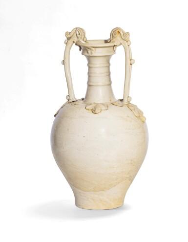 View 2. Thumbnail of Lot 37. The Eugene and Elva Bernat white-glazed 'Amphora' vase Tang dynasty | 唐 白釉雙龍耳瓶.